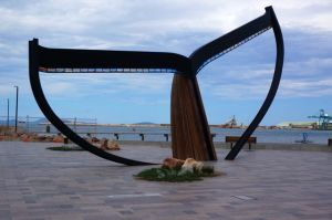 The huge wood and steel whaletail that frames a view of Esperance Harbour from midtown Esperance