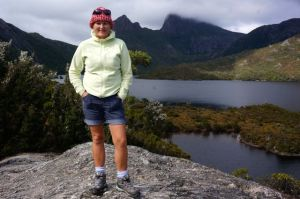 Dearne standing confidently high on Glacier Rock at Cradle Mountain